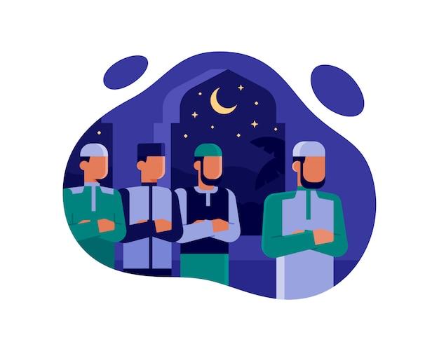 Gli uomini musulmani pregano insieme la notte alla moschea