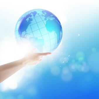 Globo umano della holding sulle sue mani sopra il cielo blu.