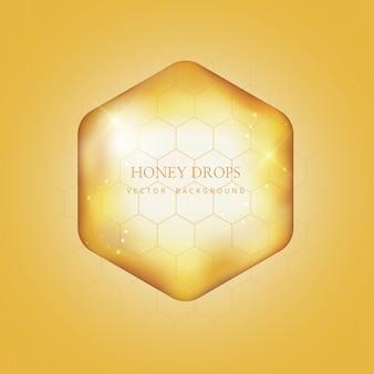Gocciolamento di miele e sfondo di miele
