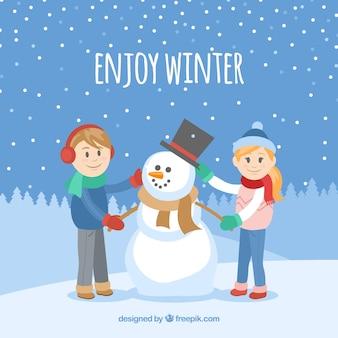 Goditi lo sfondo piatto invernale con i bambini e un pupazzo di neve