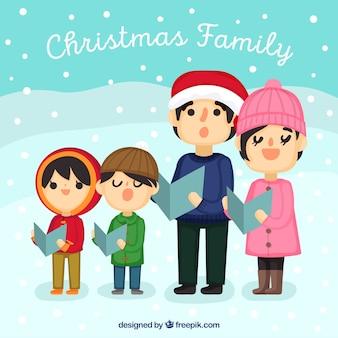 Grande famiglia cantando un canto in un giorno di neve