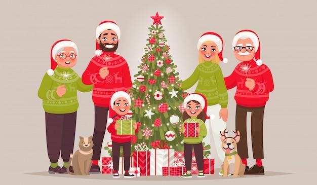Grande famiglia gioiosa vicino all'albero di natale. buon natale e felice anno nuovo