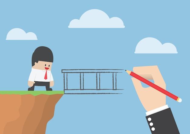 Grande mano che disegna un ponte per aiutare l'uomo d'affari