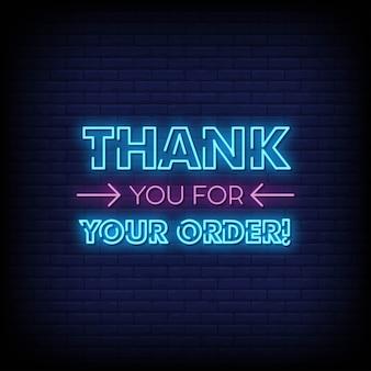Grazie per il tuo ordine insegna al neon sul muro di mattoni