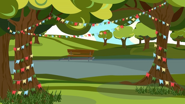 Green tree decorated, garland bunting flag nel parco