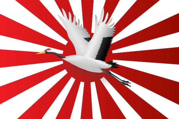 Gru giapponese che vola sulla bandiera della marina giapponese