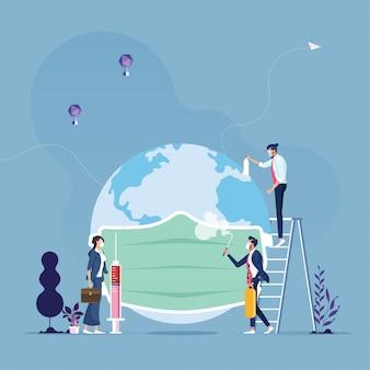 Gruppo aziendale messo sul globo con la metafora del mascheratore per salvare il mondo dal virus corona