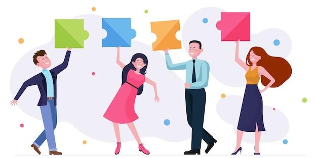 Gruppo di affari felice che gode degli elementi della festa dell'ufficio