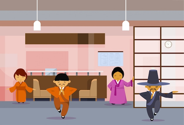 Gruppo di gente di affari asiatica che indossa i vestiti tradizionali