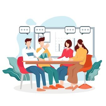 Gruppo di giovani imprenditori in una riunione in ufficio.