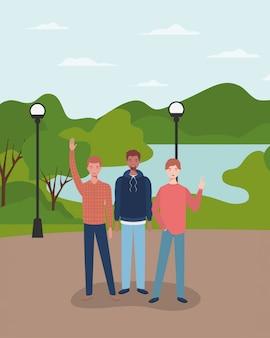 Gruppo di giovani interrazziali nei personaggi del parco