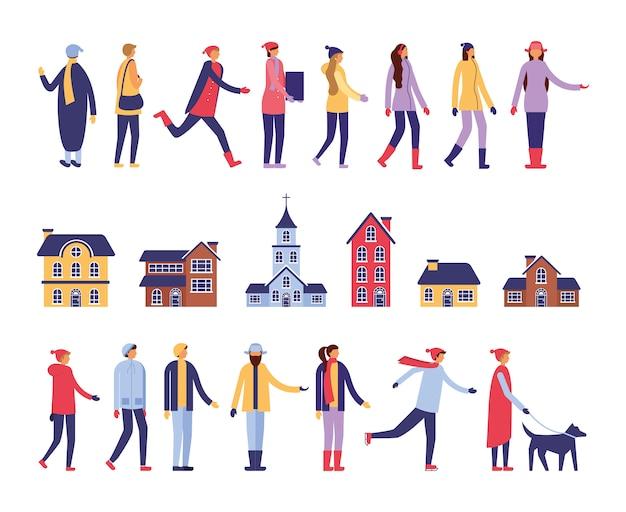 Gruppo di persone con abiti e costruzioni invernali