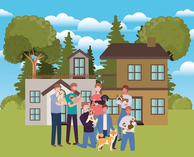 Gruppo di uomini con mascotte di cani svegli in casa all'aperto