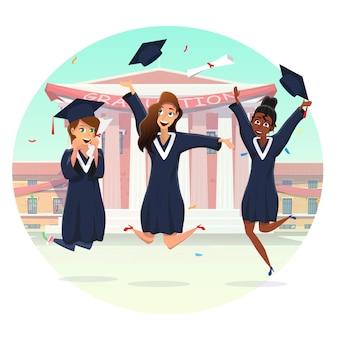 Gruppo felice delle studentesse che celebra graduazione