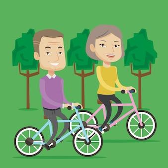 Guida senior felice delle coppie sulle biciclette nel parco