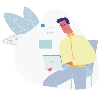 Guy sitting barbuto con internet di chiacchierata del computer portatile
