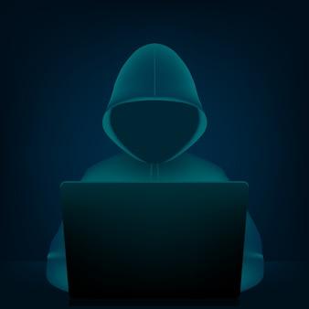 Hacker con felpa con cappuccio, viso oscuro oscurato e laptop pc.