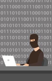Hacker usando il portatile per rubare informazioni