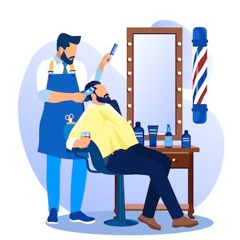 Haircutter professionale che dà taglio di capelli al cliente