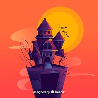 Halloween haunted house background in design piatto