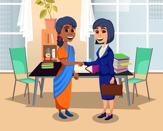 Handshake multietnico dei soci commerciali delle donne