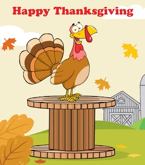 Happy thanksgiving greeting with turkey bird on a giant spool in a barnyard