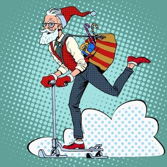 Hipster babbo natale diffonde i regali di natale su una slitta da scooter