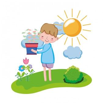 Houseplant di sollevamento del ragazzino nel paesaggio