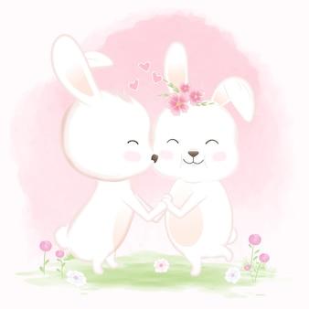 I conigli si tengono per mano con amore