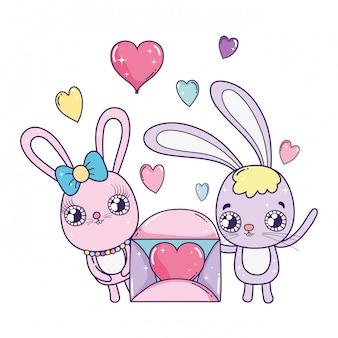 I conigli svegli si accoppiano con il giorno dei biglietti di s. valentino della busta