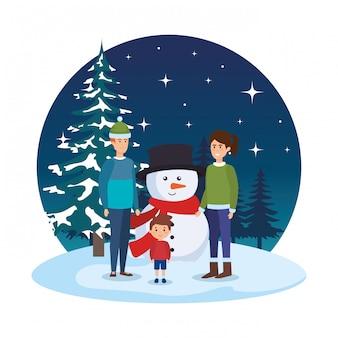 I genitori si accoppiano con i bambini e il pupazzo di neve nello snowscape