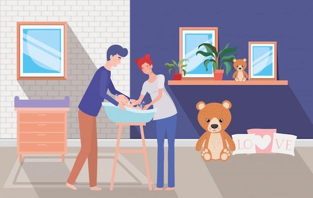 I genitori si prendono cura del neonato con il bagno