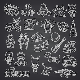 I giocattoli del bambino hanno impostato disegnato a mano e isolato sulla lavagna nera