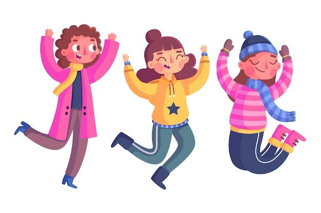 I giovani disegnati a mano indossando abiti invernali che salta insieme
