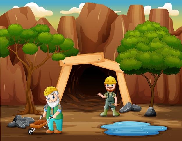 I minatori che lavorano di fronte alla miniera di carbone