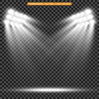 I proiettori dello stadio illuminano in modo brillante giochi sportivi serali o notturni, concerti, spettacoli, eventi. isolato su uno sfondo trasparente arene di faretti luminosi. luci brillanti. scena illuminata.