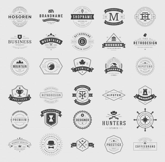 I retro logotipi e distintivi d'annata hanno messo il vettore tipografico degli elementi di progettazione