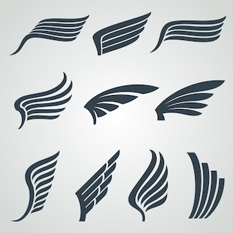 Icone delle ali di angelo e di aquila, simboli araldici di volo isolati
