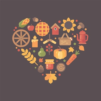 Icone piane di autunno disposte in forma di cuore. set di oggetti colorati