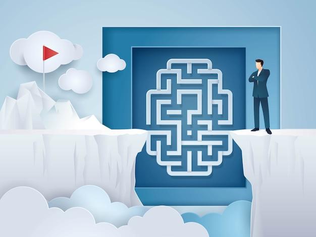 Idea di concetto di affari, uomo d'affari che esamina il cervello del labirinto fra cliff gap mountain