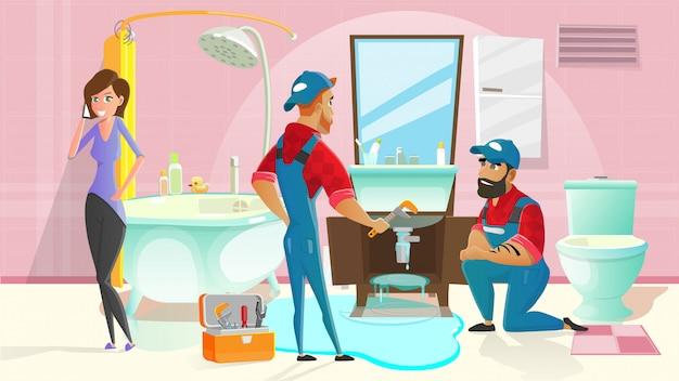 Idraulici che fermano l'acqua che perde nel bagno