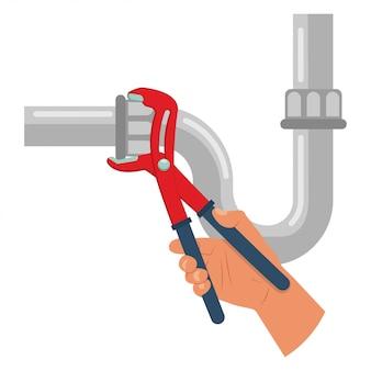 Idraulico ripari la perdita del tubo di acqua con una chiave