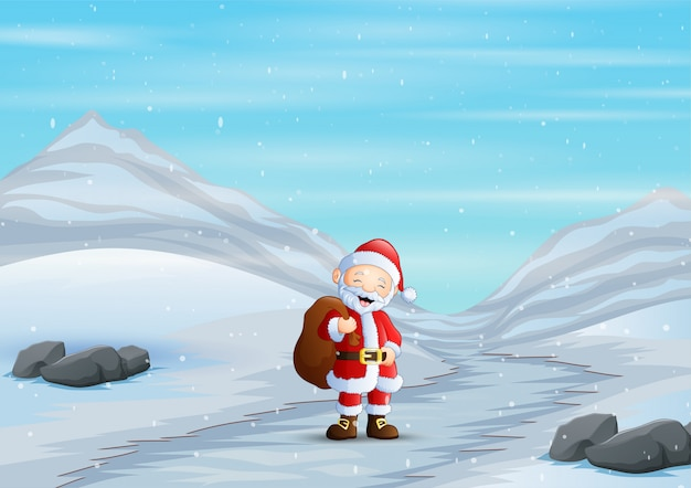 Il babbo natale che cammina attraverso la strada nevosa in inverno