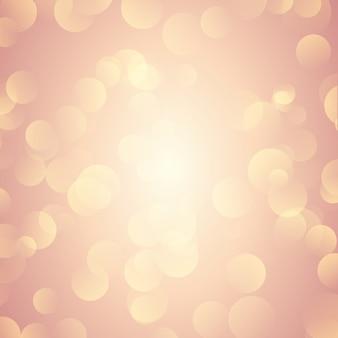 Il bokeh dell'oro di rosa illumina la priorità bassa