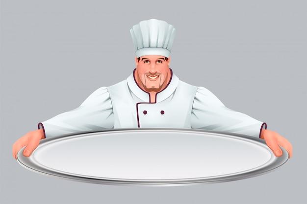 Il capo cucina mantiene un grande vassoio vuoto