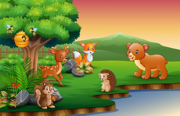 Il cartone animato degli animali si sta godendo la natura vicino al fiume