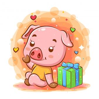 Il cartone animato di maiale rosa si trova vicino al dono dell'illustrazione