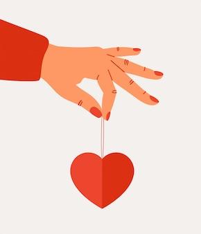 Il concetto del giorno di biglietti di s. valentino con la mano femminile tiene la carta rossa del biglietto di s. valentino di forma del cuore. vettore