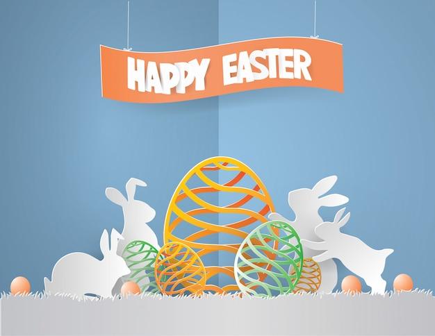 Il concetto del giorno di pasqua con coniglio della famiglia ha circondato le uova
