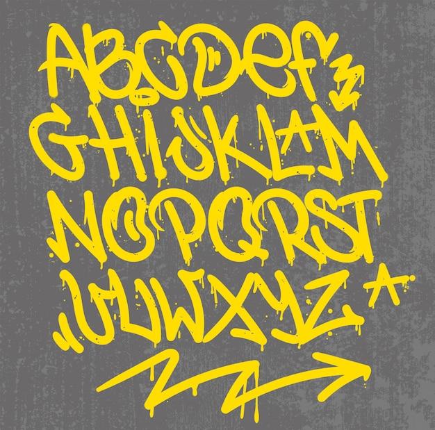 Il disegno di calligrafia delle lettere dell'etichetta di stile dei graffiti dell'alfabeto scrive l'inchiostro della spazzola dell'indicatore o lo spruzzo di vernice dell'aerosol. stile selvaggio gratuito per wall city urban.